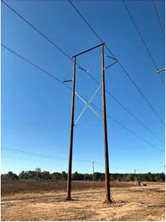 An H-frame transmission tower, similar to what will be used for the Holly Springs transmission line.