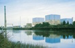 Small image of Brunswick Nuclear Plant exterior with reflection in lake
