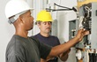 Technicians working at a circuit breaker