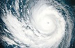 Satellite photo showing the eye of a hurricane and the swirl of clouds surrounding the eye.