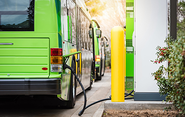 electric bus being charged